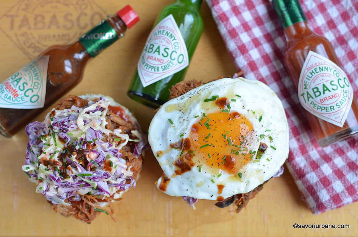 pulled pork with tabasco sauces coleslaw and fried egg